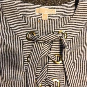 Women's sleeveless, long tunic blouse.